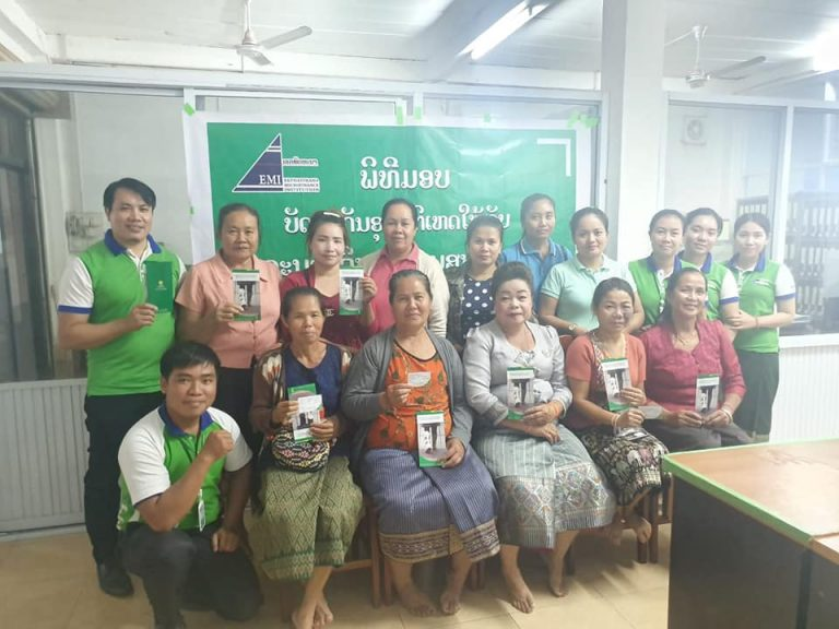 EMI Phonhong Unit give personal accident insurance card to the center meeting management team.