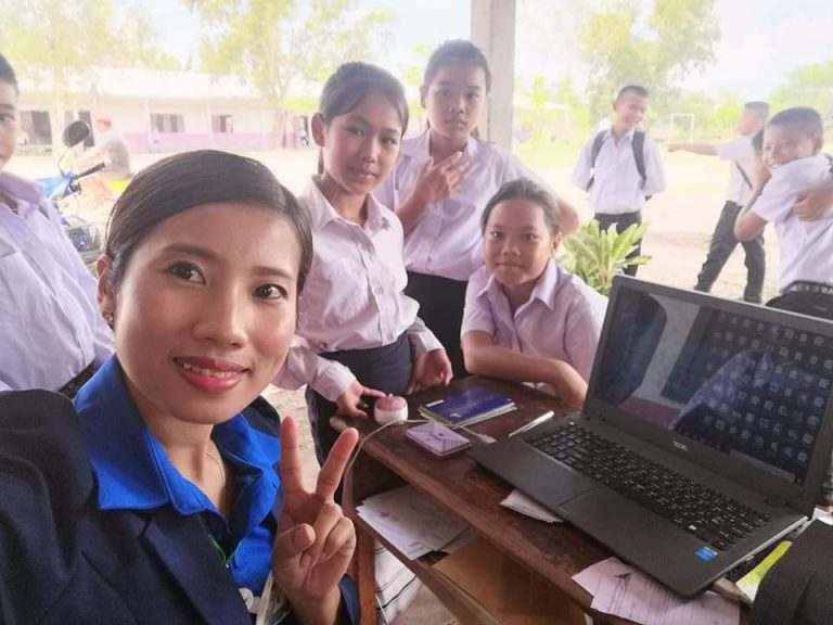 EMI Saving Mobilization Department does the service in the school and the students are excited to save money during the new term.