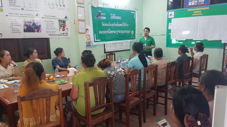 EMI Thoulakhom Unit give personal accident insurance card of Laovivat Insurance Co., Ltd to the center meeting management team.