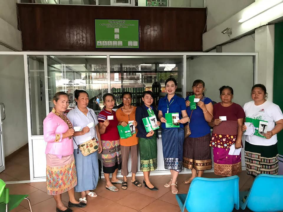 EMI Sisattanak Unit give personal accident insurance card to the center meeting management team.