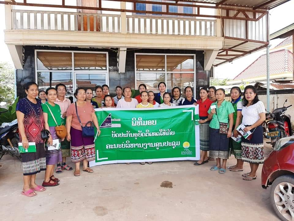 EMI Naxaythong Unit give personal accident insurance card to the center meeting management team.